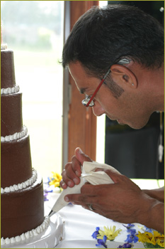 Albert Trevino decorating cake