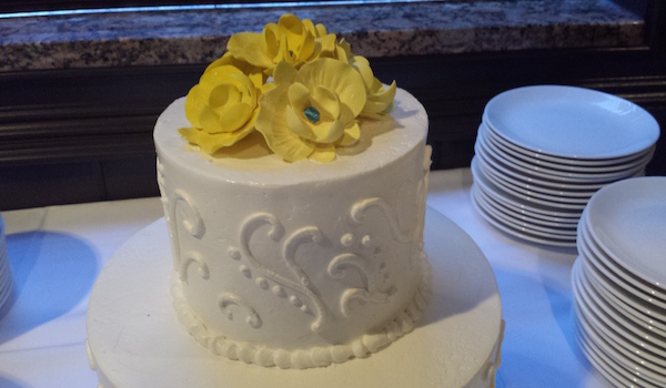small cake with yellow flowers