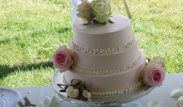 three tiered pink cake with roses
