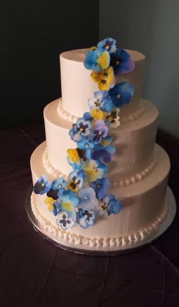three tiered cake with blue flowers