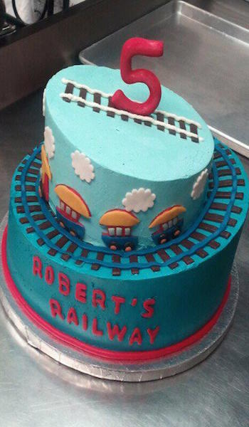 two tiered blue train 5th birthday cake