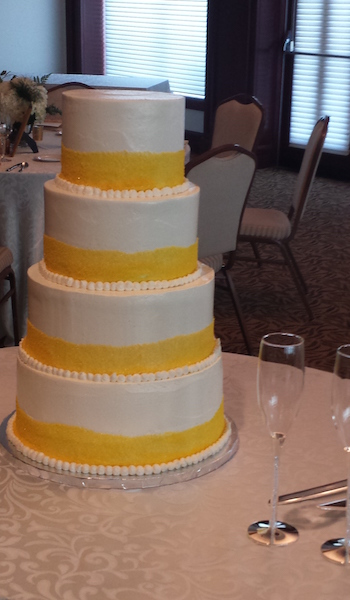 four tiered white and yellow cake