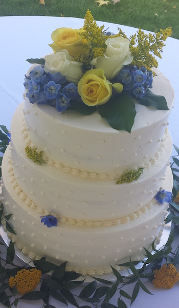 three tiered white cake with flowers